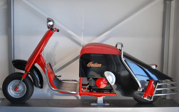 """<p>Branching Out: Following World War II, scooters exploded onto the market, offering a cheaper more economical mode of transportation. Indian, following the lead of other motorcycle manufacturers, added a scooter to its model line up in 1947, working with Lowther Manufacturing of Joliette, Illinois to build them.</p> <p>Advertised as being """"scientifically engineered and artistically styled"""", the Stylemaster was the premier model in a series of three, in which buyers could choose between a Briggs and Stratton four- or six-horsepower engine.</p> <p>The Sylemaster was intended more so for private buyers who appreciated its trendy features more than the business owners to whom other Indian scooters were marketed. Those features included a sheet-metal tail panel and three-bar chrome rear bumper.</p>"""