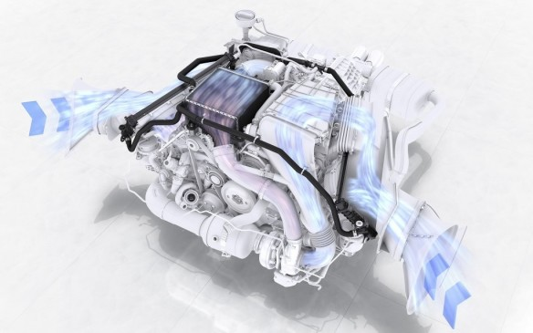 <p><strong></strong>In the new model, cooling air is taken in from large vents behind the doors on each side and mixes with exhaust air from the turbos to cool its own radiator.</p>