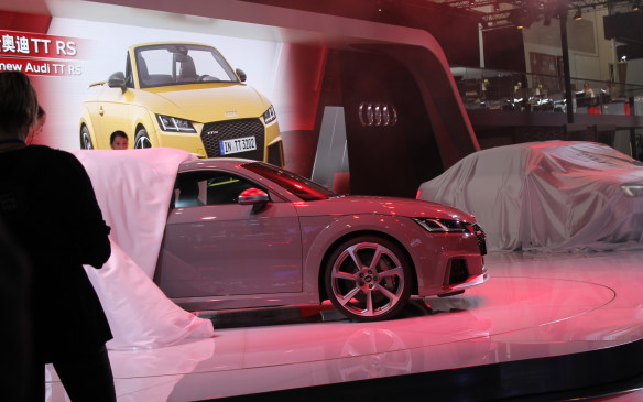 <p>Most of the cars on display will be sold only in China, but there are some exceptions, like the new Audi TT RS that debuted here. That's a long wheelbase A4 still under wraps on the stage behind it, which is just for the local market.</p>