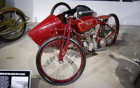 """<p>As motorcycle racing grew in popularity, the challenge of racing a motorcycle with a sidecar only increased the thrill. The added power of a larger displacement engine in some models made them a popular choice for pulling a sidecar around a race track.</p> <p>With the brand's race results on a downturn, Indian developed a new Powerplus engine that was introduced in 1919 and the following year, their Daytona Racer appeared. """"Flxicars"""", which provided passenger counterweight, improved traction, and reduced outside force, completed the sidecar version of the Daytona Racer with the Powerplus engine, allowing for greater speeds in turns around the race track.</p>"""