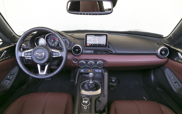 <p>By comparison, the MX-5, in GT trim, looks and feels surprisingly dapper, especially with the rich, brown leather in our test car. The stitching on the seats is artfully done and most of the surfaces are finished in expensive feeling material. </p>