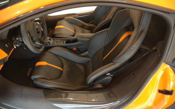 <p>Once installed, most drivers should be able to get comfortably arranged at the controls. The wheel tilts and telescopes, while six-way seat adjustment is standard, with power height adjustment; a full-power 8-way seat is optional. Also present are cup-holders, and more storage space than on any other McLaren.</p>