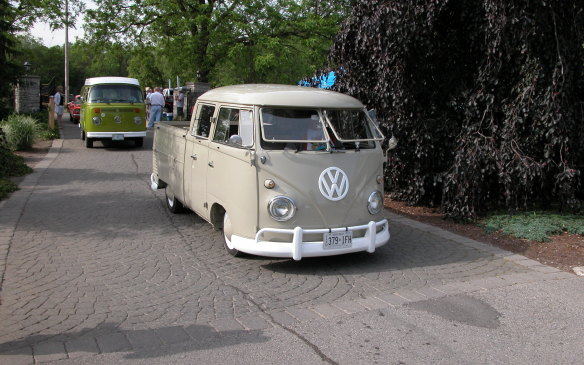 <p>A pair of Volkswagen vans, the older one a rare pickup variant.</p>