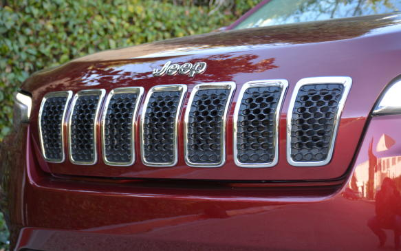 <p>As with most Jeep's, the brand's signature seven-slot grille is the most recognizable feature on this Cherokee. It's been tweaked for a more premium look through the use of chrome integrated in its hood. Those aforementioned LED headlamps and daytime running lamps are standard and complement the grille well. In addition, the new lighting has improved visibility by 57% over the previous headlamps.</p>