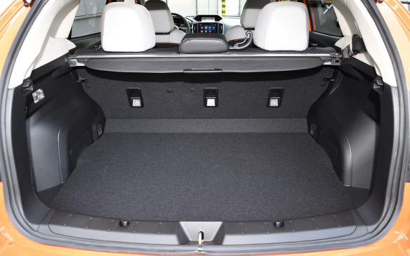<p>Dogs won't like the Crosstrek if they have to ride in the back, because the rear lip into the cargo area is quite high, but there' are 588 litres of capacity with the seats up and 1,565 litres with the seats down – that's 95 litres more than before. The base of the door opening is now much wider, by an extra 10 cm, so it's easier to get wide objects in and out, and the wheel wells protrude very little into the luggage area.</p>