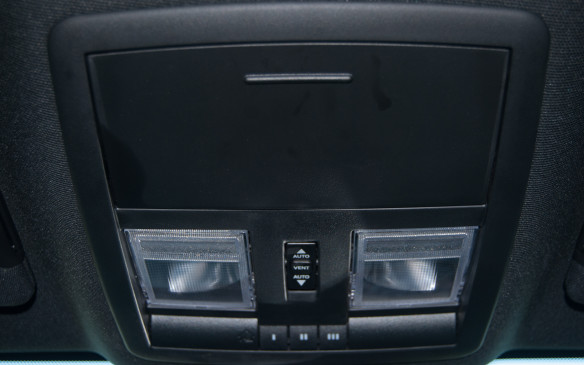 <p>Above the rear-view mirror are more hidden treasures, including three programmable buttons for opening garage doors. There's also a drop-down compartment, large enough to hide a couple pair of sunglasses or prescription glasses. You will also find the interior dome lights for lighting your cabin when needed. </p>