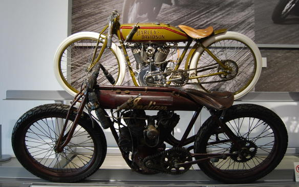 """<p><strong></strong></p> <p><strong>The Wrecking Crew:</strong> Although Harley-Davidsons were known for their durability, they were still not known for their speed.</p> <p>Introducing the """"Wrecking Crew"""". A team hired by Harley-Davidson in 1919 to address their need to achieve distinction in competition. They won numerous competitions, including all eight National Championship races in 1922.</p> <p>Unfortunately the intentionally high price of Harley-Davidson's competition bikes and restricted replacement parts overshadowed the """"Wrecking Crew's"""" accomplishments.</p> <p>***</p> <p><strong>A Winning Formula:</strong> Still under the guise of the Hendee Manufacturing Company, Indian produced its first V-Twin """"Double Cylinder Racer"""" in 1906.</p> <p>Indian's racing success captured the attention of U.S. and European enthusiasts after their record-breaking transcontinental trek from San Francisco to New York and victories in the 1907 and 1908 1000 Mile Trials.</p> <p>Indian rose to the top, quickly becoming a popular base for building personalized racing motorcycles. More so after every American speed and distance record was claimed by Indian riders and the top three positions at the first Isle of Man race were also given to Indian racers.</p>"""
