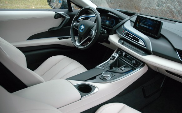 <p>There's only one cupholder, but otherwise the i8 provides a decent array of cabin storage options. There are two lidded storage compartments atop the centre tunnel, a small bin in front of the shift lever, a net pouch in the passenger footwell and a fair-size glove box. Door pockets, not so much.</p>