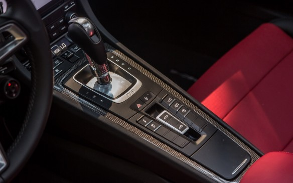 "<p>A button on the centre console allows the driver to configure driving modes from normal to sport or sport plus with a new ""individual"" setting available for the 718. The optional Porsche Active Suspension Management system (PASM) brings a 10-mm lower ride height and a new PASM Sport Suspension brings a 20—mm reduction. </p>"