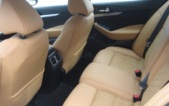<p> The rear seats have 60/40-split seatbacks that fold down, while rear ventilation ducts deliver heated or cooled air from the standard dual-zone automatic climate control system.</p>