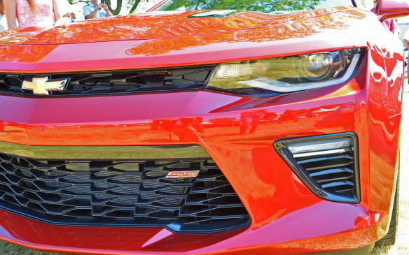 <p>There's no mistaking the face of the 2016 Camaro. It begins with the subtly sculpted piercing eyes, ahem, lights. These front headlamps are accented with a LED lightstrip that's become standard kit for most new cars of late. The SS model pictured here features a large radiator behind an aggressive split grille.</p>
