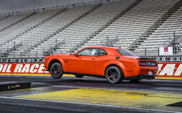 <p>Of course, the 2018 Dodge Challenger SRT Demon became the first-ever production car to lift its front wheels in a standing start and keep them aloft over a meticulously-measured distance of 0.89 metre (2.92 ft). This was good enough to get into the famous Guinness Book of World Records, with the official certificate to prove it. In other words, the Demon can pop a wheelie, a feat made even more impressive by the fact that it carries 58% of its more than two American tons (1,939 kg / 4,276 lb) on its front wheels.</p>