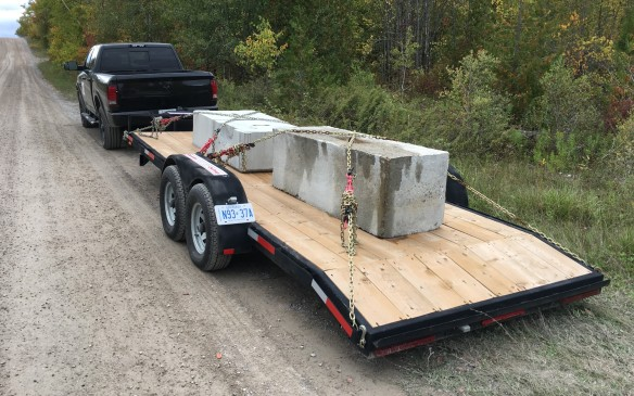 <p>A critical issue for many truck buyers is towing capability – how well does a truck haul a trailer. For Truck King testing, a 908-kg (2,000-lb) dual-axle flatbed was hitched to each truck, then loaded with a weight appropriate for its rated towing capacity. The two mid-size entries took on a total weight of 1816 kg (4,000 lb), including the trailer; the full-size ½-ton trucks were challenged by a total load of 2722 kg (6,000 lb), while the ¾-ton pickups had to haul 4536 kg (10,000 lb). Both Rams – the 1500 and the 2500 – scored highest in their categories in towing capability, while the Chevy Colorado proved to be better a s a hauler than the Ridgeline in the mid-size class.    </p>