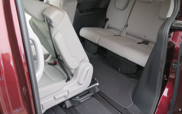<p>If there is no occupant in the seat, it can also be tilted forward, but even with a child seat in place, access is a breeze. And, there is ample room back there for real people!  </p>