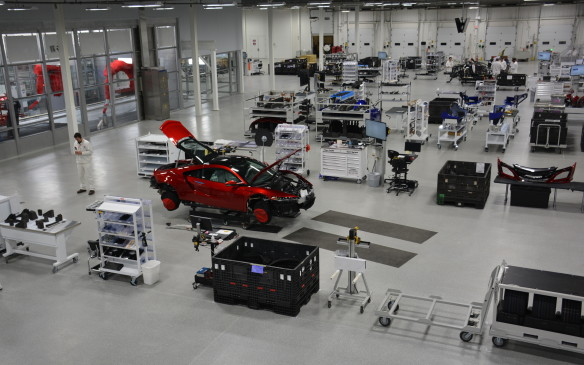 <p>The PMC was built with a clean-sheet approach, similar to the all-new NSX itself. Clement D'Souza, Acura NSX Engineering Large Project Leader felt the NSX centre had to capture the essence of a small-volume manufacturing plant.</p> <p>The environment is open and spotless and built from the inside out starting with quality confirmation in the middle.</p>