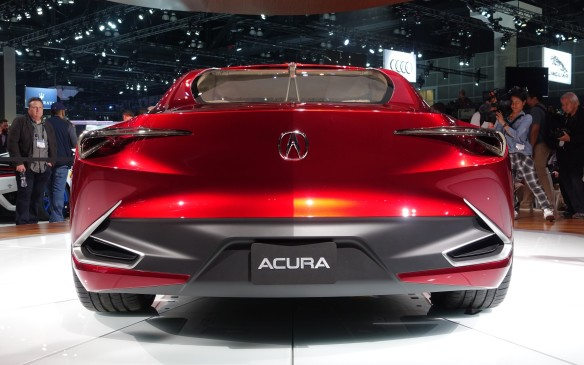 <p>Clean, sweeping surfaces, clip-like details, slender light bezels and Acura's chrome caliper badge underline the Precision Concept's ultra-wide stance.</p>