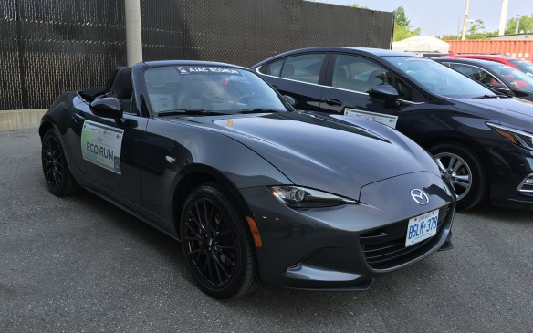 <p>The 2016 Mazda MX-5 is the fourth generation of this fun-to-drive sports car. As part of the development of this latest iteration, Mazda engineers were able to trim more than 100 kilograms from its mass, compared to the previous model. Not only does the weight saving enhance its nimble driving dynamics, it also helps reduce fuel consumption. Power is supplied by a direct-injected 2.0-litre SKYACTIV-G four-cylinder with 16 valves and double overhead camshafts. It produces 155 horsepower at 6,000 rpm and 148 lb-ft of torque at 4,600 revs using premium-grade fuel. The engine in the EcoRun entry was coupled to a six-speed manual gearbox, although a six-speed automatic transmission with Sport mode and Drive Selection switch is available. This 1,058-kilogram, front-engine/rear-wheel-drive two-seater ($41,495 as tested) is rated by NRCan at 8.8 L/100 km city, 6.9 highway, 7.8 combined, but EcoRun drivers were able to record a combined consumption rate of 5.3. I averaged 5.6 L/100 km (despite some spirited driving) during the leg from Toronto to Oshawa.</p>
