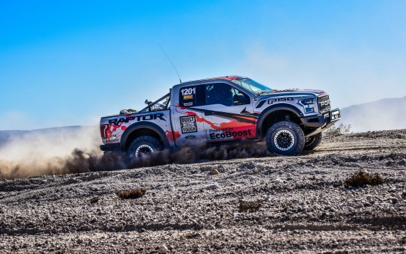 <p>With minimal modifications (heavy duty versions of the Fox Racing shocks and springs, roll cage, five-point harness, light bars, fuel cell, GPS race navigation with digital instruments and data logger), the new Raptor had already become the first 'stock' truck to finish a race in the 'Best in the Desert' factory stock class for full-sized trucks (class 1200). It was indeed one of only 19 race machines in this group to finish out of the 68 who took the start in yet another off-road classic; the Mint 400 that ran in the Nevada desert last March.</p>