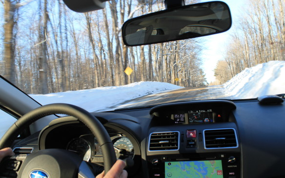 <p>Some of the roads were plowed right down to the dirt, depending on which township we were in. Often, there was ice under the right tires and gravel under the left – <em>split mu</em> conditions in tech-speak – so the Impreza's computer had to determine how much drive to send through the differential to each wheel.</p>