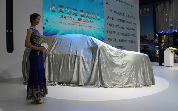 <p>Auto China is the largest auto show in Asia and there are more than 200 automakers in China, but only a fraction of them, like Ssangyong here, are able to display their new vehicles in the show's eight giant halls.</p>