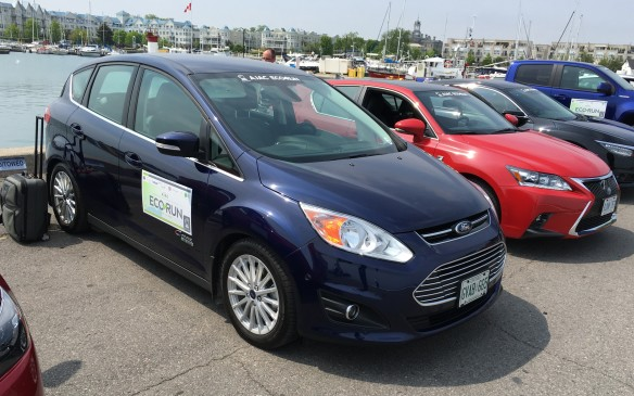 <p>The 2016 Ford C-MAX Energi plug-in hybrid is powered by a next-generation, power-split technology that Ford says enables the car to run in electric mode at higher speeds than any other hybrid. A 2.0-litre four-cylinder gas engine (running on the Atkinson cycle) combines with an electric motor to generate a combined total of 188 horsepower. The output is channeled through an eCVT hybrid power-split transaxle. The C-MAX Energi, which can be charged using either a standard 120-volt outlet or an available 240-volt charging station, features SmartGauge with EcoGuide, which enables the driver to monitor fuel economy readings. The MyFord Mobile app allows users to monitor charging, find charge stations, receive alerts and plan trips using their smartphones. NRCan rates this compact front-wheel-drive hatchback at 5.6 L/100 km city, 6.4 highway, 6.0 combined. Actual fuel consumption during EcoRun was 4.0.</p>