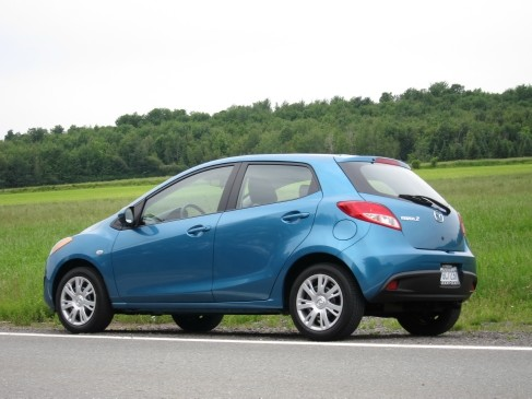 "<p><strong>2011-13 Mazda 2</strong></p> <p>The 2's 1.5-L DOHC four cylinder engine produced just 100 horsepower; then again, the wee hatchback weighed 108 kg less than a Honda Fit. U.K.'s <em>Car</em> magazine called the 2 the coolest ""supermini"" with a lively chassis. Given its gadget-free interior and rudimentary five-speed manual and four-speed automatic transmissions, the Mazda 2 harks back to a simpler time. For budget-minded buyers, this back-to-basics automobile has lots of goodness baked in.</p>"