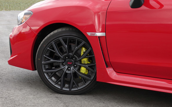<p>All versions of the WRX STI get new Brembo brakes with bigger, 340 mm rotors in front and 326 mm rotors at the rear, all four now drilled to help them stay cooler and keep pads clean. Clamping them are bright yellow calipers with six pistons in front and two at the rear. Shown here are the new 19-inch alloy wheels that are fitted on Sport and Sport Tech models, with Yokohama Advan Sport tires in size 245/35 R19. The 'base' STI runs on 18-inch alloys with Dunlop SP Sport Maxx 245/40 R18 tires.</p>
