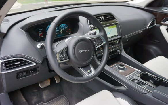 <p>At first glance the F-Pace's instrument panel looks very similar, and indeed many parts such as the air vents and the centre stack with its 10.2-inch integrated touch-screen and rotary gear selector are the same. But the SUV's IP sculpting is subtly distinct, and inside the instrument binnacle the F-Pace (a newer design than the XE) offers something the XE doesn't ...</p>