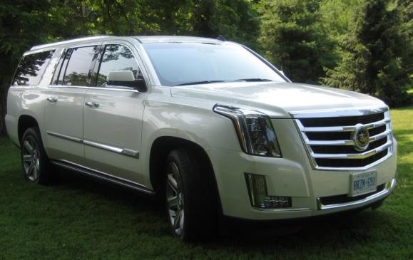 2015 Cadillac Escalade - side 3/4 view