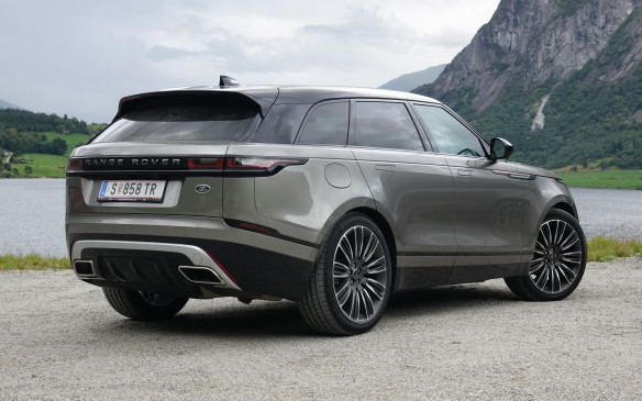 <p>The Velar's smooth shape is no accident. Great care was taken to integrate all exterior elements with the narrowest gaps and fewest appendages possible. The large exhaust tips, mounted almost flush with the extractor, are the best example. The Velar's drag coefficient is an excellent 0.32 for diesel-powered versions and 0.36 for V-6 models, with their wider tires. Even more so on this First Edition Velar, with its 22-inch split-spoke wheels and tires that fill the wheel wells completely and work wonders for the look. Much less for ride quality, though. The Flux Silver satin paint is exclusive to this model.</p>