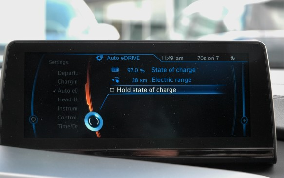 <p>Here the iDrive screen shows that the almost fully-charged battery could give you 28 km of exclusively electric driving in eDrive mode. Or at any point you can elect to save the charge remaining for later use, for example when driving in the city, or arriving home late at night without waking your spou … er, disturbing the neighbours.</p>