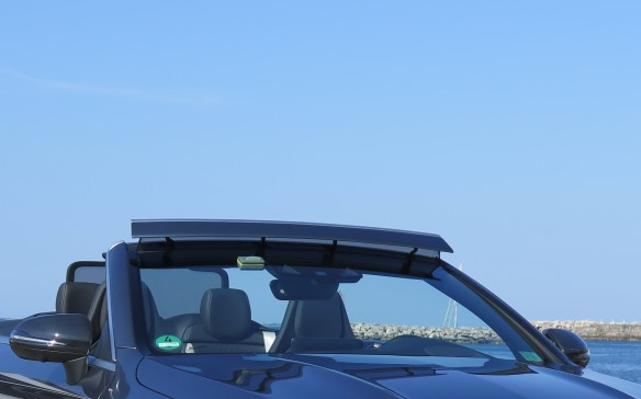 <p>It is with the top down, that you come to appreciate the lengths to which this company has gone to ensure topless motoring can be enjoyed in less than perfect conditions. Press a switch on the centre console and a louvre atop the windshield moves into position to deflect the wind up and over the heads of occupants. At the same time a screen raises from behind the rear seats to all but eliminate the buffeting common to convertibles – and cabriolets.</p>