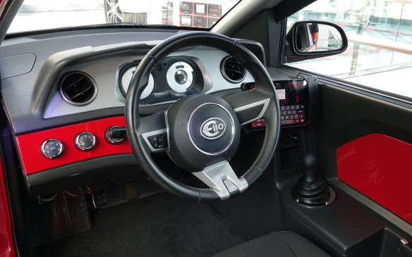 <p>The fit and finish is rather austere, the instrumentation minimal and the transmission manual. But how much should we reasonably expect, let alone demand, with a base price now set at $US 7,300? The latest E1c prototype includes side-curtain airbags and one for the driver, in the steering wheel hub.</p>