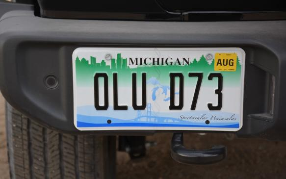 <p>Previous generations has seen the license plate hanging off the side, which could get caught in awkward situations both on and off the road. For 2018, Jeep has revised its license plate arrangement and relocated it to a more traditional setting, inside the back bumper on the left corner.</p>