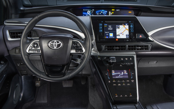 <p>The instrument panel strays from the conventional layout with the display readouts stacked in the centre, as in the Prius, rather than the typical positioning in front of the driver. High on the instrument panel, just below the base of the windshield, is a large, centrally positioned digital display that provides the driver with essential information, such as vehicle speed, fuel level and range. To its right is a second display that shows how the hybrid system is operating. Although I wasn't keen on the layout at first, I quickly found the positioning to be easily readable, only having to shift my line of sight slightly from the road to the readouts.</p>