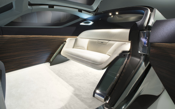 <p>This futuristic Rolls-Royce drives itself, providing a quiet interior of Macassar wood and hand-twisted silk that is a private haven from the world outside.</p>
