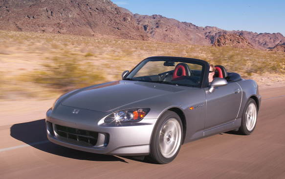 <p>Honda's slick S2000 two-seater roadster was incredibly rigid thanks to its X-shaped steel chassis reinforcement, while its lightweight aluminum engine squatted behind the front axle to achieve ideal 50/50 weight distribution. Almost unheard of for a Honda, the S2000 scorched its rear tires and not the fronts. Its 2.0-litre four-cylinder engine provided 120 horsepower-per-litre (240 horsepower in total) – the highest specific output (hp/L) of any engine at the time, without the aid of turbos or superchargers. Torque was modest at just 153 lb-ft, way up at 7500 rpm.</p>