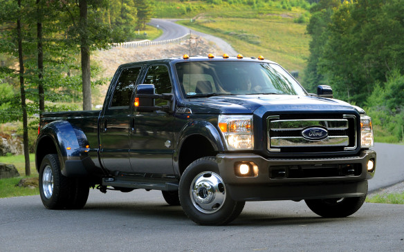 <p>Certainly the Ford F-350 SD would be a difficult choice for navigating those tiddly streets. At nearly 6,700 millimetres long in full long-box, long-wheelbase form, it would take up three spaces when parking. The dually is 2,440 millimetres across at the back, and would happily take out cyclists and light posts equally well. Those two factors alone, not to mention the 17.2-metre turning circle, are enough to send chills through most drivers even in far more spacious surroundings.</p>