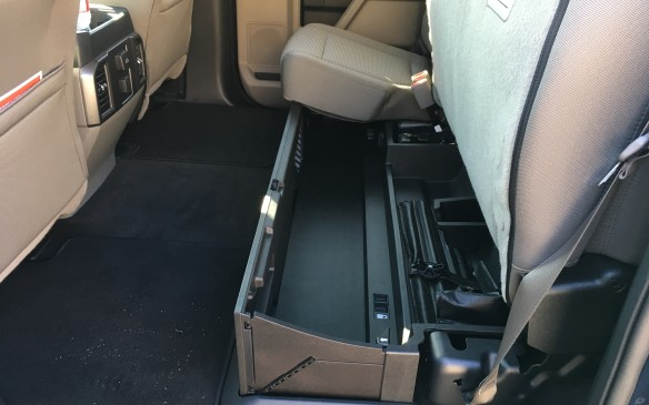 <p>For those opting for a Crew Cab model, a new lockable rear seat storage bin is available. This novel design collapses flat on the floor, but can be easily popped up into its bin configuration. The rear seat cushion can then be lowered over it and locked, providing a secure storage space for valuables.</p>