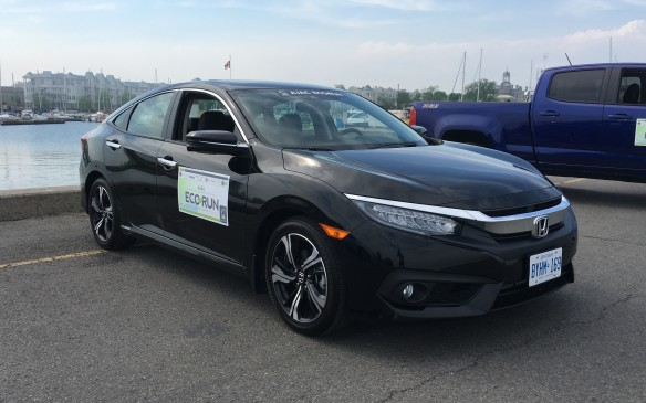 <p>The 2016 Honda Civic sedan participating in EcoRun was the Touring edition and was equipped with Honda's new 16-valve, double-overhead camshaft, 1.5-litre turbocharged four-cylinder matched to a CVT (continuously variable transmission.) This is the tenth generation of Honda's top-selling vehicle and it has been totally redesigned, from its all-new platform architecture to a new, sporty exterior design and sophisticated interior. NRCan rates this compact front-wheel-drive sedan at 7.6 L/100 km city, 5.5 highway, 6.7 combined. Actual fuel consumption during EcoRun was 4.6.</p>