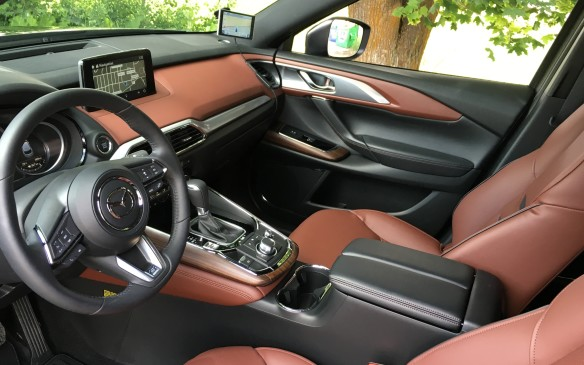 <p>One element that sets the new CX-9 apart from its predecessors is the interior. It's simply stunning, especially in the premium Signature edition shown here. The execution and craftsmanship are superb. In fact, remove the badging and one could be easily convinced this was the cabin of a high-end German crossover such as an Audi or Mercedes-Benz. The occupants are enveloped with luxurious appointments – rich Nappa leather with contrasting stitching, as well as generous use of aluminum trim and real wood accents. Heated front seats with eight-way power adjustable driver's seat are standard across all trim levels, while all but the base GS model also have a heated, leather-wrapped steering wheel.</p>
