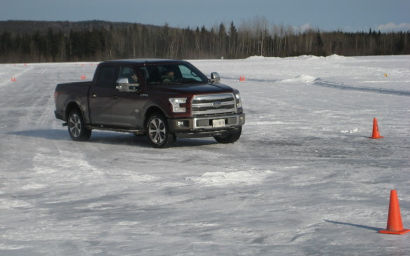 <p>An icy, frozen taxiway was the ideal venue to put the F-150's stability and traction control systems to the test. The truck stayed on course, although it could be made to wag its tail with aggressive use of the accelerator. Understeer was never an issue either, unless the driver pushed the limits too far. Overall, the F-150's behavior on ice was commendable, thanks to its electronic control systems, and certainly gave the driver a sense of confidence in such adverse conditions.</p>