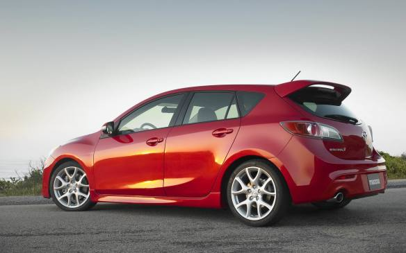 <p>The whole thing got wrapped in the new 3's hatchback bodywork, complete with its demented-clown grin, but fans are able to overlook the fascia in favour of the functioning hood scoop that's a harbinger of good things, such as 0 to 97 km/h in 5.8 seconds, 0.92 g of lateral grip and excellent stopping power. Despite the electronic aids, the torque steer is still pronounced, which doesn't compare well to more refined cars like VW's GTI. The Mazdaspeed offers a more visceral experience with its noisy engine, scalpel-like steering and smoking tires. At the same time, the Japanese-sourced Speed 3 does not disappoint in terms of reliability, though watch for worn clutches.</p>