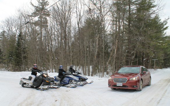 <p>There was other traffic too, even better suited to the snow-covered roads. These snowmobile riders shared the highway with us for a while. They were quicker and noisier, but we were warmer and more comfortable.</p>