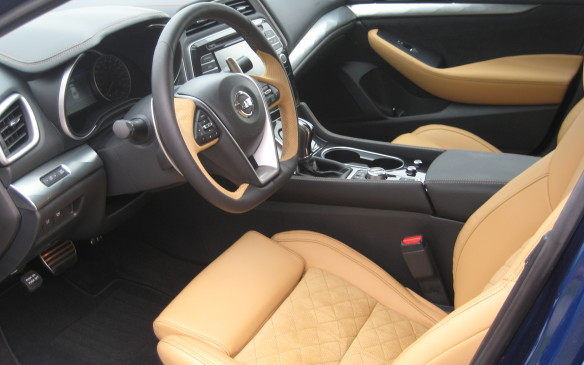 <p>The interior design continues the fighter jet theme, with the layout intended to feel like a cockpit. The centre console is tilted seven degrees toward the driver, just like in Nissan's GT-R sports car. Leather trim is standard across the model lineup and heated front seats and a heated, leather-wrapped, flat bottomed steering wheel are also standard.</p>