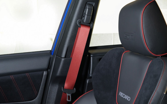 <p>All versions of the STI are now equipped with red seat belts that match the leather stitching and piping for all occupants. Thankfully, they are not as gaudy and certainly not as outrageously expensive as in several reputed German sport machines.</p>