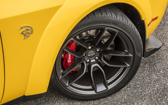 <p>The Widebody gets Pirelli P-Zero performance boots in size 305/35ZR20, mounted on these 20x11 inch Devil's Rim alloy wheels, to replace the Hellcat's 275/40ZR20 tires. With wheel tracks increased by 42 and 51 mm, front and rear, lateral acceleration goes up from 0.93 g to 0.97g while cornering. SRT also says that the additional bite slices a tenth of a second from the 0-60 mph sprint and three-tenths off the Hellcat's quarter-mile clocking, down to an impressive 10.9 seconds. Braking performance and distances, already exceptional on the Hellcat, for its weight and girth, should be even better with the Widebody.</p>