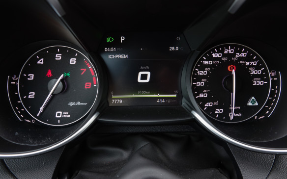 <p>In this age of huge virtual displays, the Alfa Romeo goes old school with this set of large, classic white-on-black analog gauges. In the Quadrifoglio, the speedometer reaches past the 200 mph mark to hit 330 km/h a few millimeters lower. The small, four-leaf clover crest to the right is a nice touch. Between the large speedometer and tachometer gauges sits a full-colour, 7-inch thin-film transistor (TFT) screen with some basic information. Not much.</p>