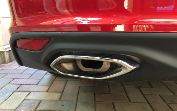 <p>Chromed exhaust tips peek out below the sculpted rear fascia.</p>