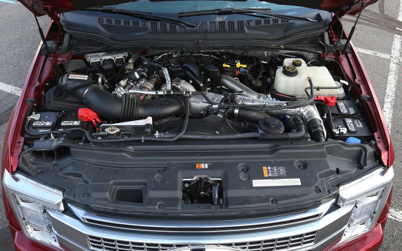 <p>Three engines are offered in the Super Duty lineup, all paired with six-speed automatic transmissions, although whispers suggest a new 10-speed automatic, jointly developed with General Motors, isn't too far down the road. The base engine is a 6.2-litre gasoline V-8 that's E85 Flex Fuel capable and can also be ordered with a natural gas/propane prep package from the factory. It delivers 385 horsepower and the torque output has been boosted to 430 lb-ft, the best in its class.</p> <p>A second gasoline-fuelled engine is also available – a 6.8-litre V-10 that's rated at 450 horsepower and a stout 550 lb-ft of torque.</p> <p>The real workhorse under the hood, however, is the optional second-generation Power Stroke diesel V-8. This 32-valve, 6.7-litre monster churns out 440 horsepower and a staggering torque output of 925 lb-ft, available at just 1,800 revs. Ford engineers have been able to generate this best-in-class performance by upgrading the fuel injectors and fuel pump and fitted the larger turbocharger with a unique exhaust downpipe that's shaped like a cobra's head. This design reduces exhaust gas restrictions coming out of the turbo, improving performance.</p> <p>Hauling a 30-foot trailer with more than 10,000 lb (4535 kg) aboard didn't faze the 6.7-litre diesel I tested one bit. It accelerated from a standstill as though there was nothing hitched to its tail and effortlessly maintained cruising speed up steep grades.   </p>